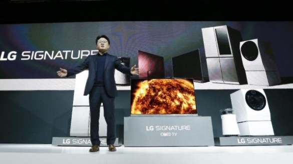 Dr. Skott Ahn, President and Chief Technology Officer for LG Electronics, displays new elements to the LG Signature lineup during a news conference preview for CES International, Tuesday, Jan. 5, 2016, in Las Vegas. LG unveiled a new OLED 4K TV with HDR, along with several other household electronics items at the news conference. (AP Photo/Gregory Bull)