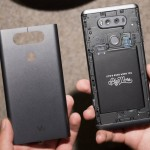 In this Tuesday, Aug. 30, 2016, photo, the removable battery plate, left, is shown with the LG V20, in New York. The phone opens like a cosmetic powder case, allowing users to swap batteries. (AP Photo/Mark Lennihan)